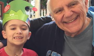 Ryan Sabin celebrating with his grandfather Nick Sabin